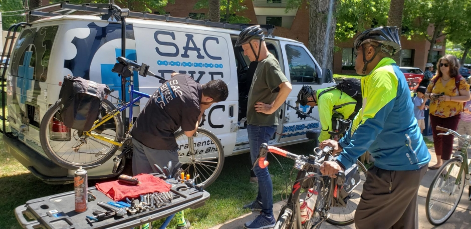 Charley Cross gets his bike checked over by Michael Harting, the Sac Bike Doctor, at the launch event for May is Bike Month.