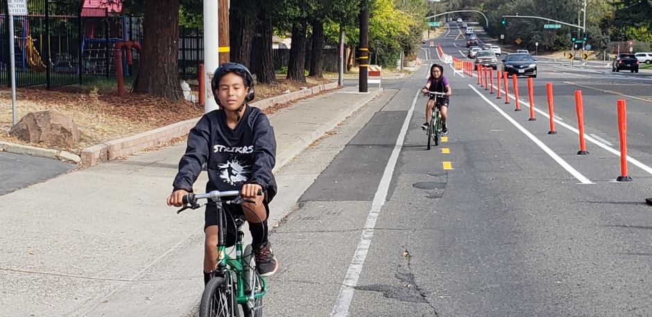 Nathan Morales, left, and Bethany Morales practice their bike riding skills in the safety of a temporary bike lane on Old Auburn Rd. In Citrus Heights.