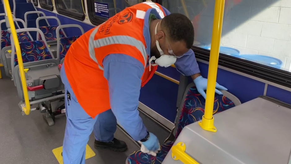 A SacRT worker disinfecting a bus.